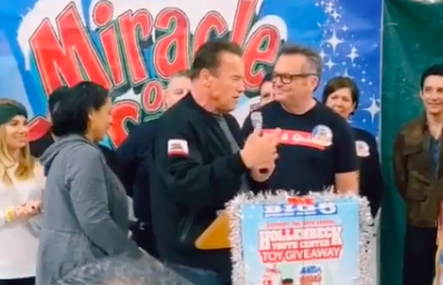 Arnold Schwarzenegger and Tom Arnold host Christmas toy giveaway