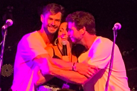 Chris and Liam Hemsworth hug Celeste Barber at Make It Rain:Fund the Firies 2020 (Photo: @enkoala/Instagram)