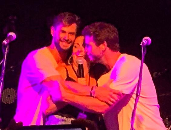 Chris and Liam Hemsworth hug Celeste Barber at Make It Rain:Fund the Firies 2020 (Photo: @enkoala/Instagram)