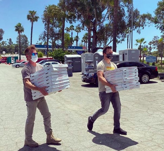 Sean Penn and Dane Cook deliver pizzas to CORE volunteers (Photo courtesy CORE)