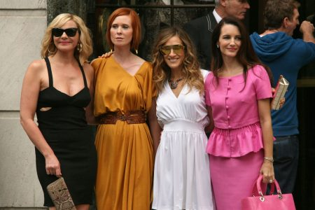 Kim Catrall, Cynthia Nixon, Sarah Jessica Parker and Kristin Davis pose for a photo on the set of Sex And The City.