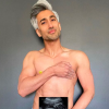 Tan France is topless and holds an ultrasound photo of her his stomach.