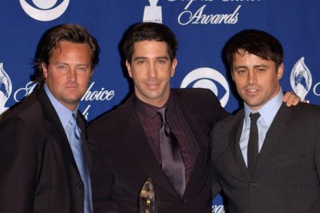 Mathew Perry, David Schwimmer and Matt Leblanc post in suits at a red carpet event.