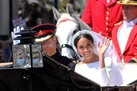 Prince Harry and Duchess Meghan waving at crowds on their wedding day