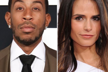 Ludacris and Jordana Brewster pose for the camera on a red carpet.