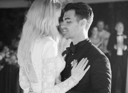 Sophie Turner and Joe Jonas on their wedding day. A black and white photo of them holding each other on the dance floor.