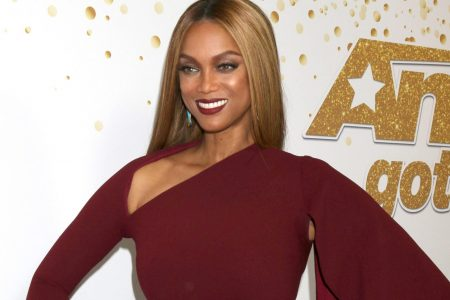 Tyra Banks smiles at a red carpet event