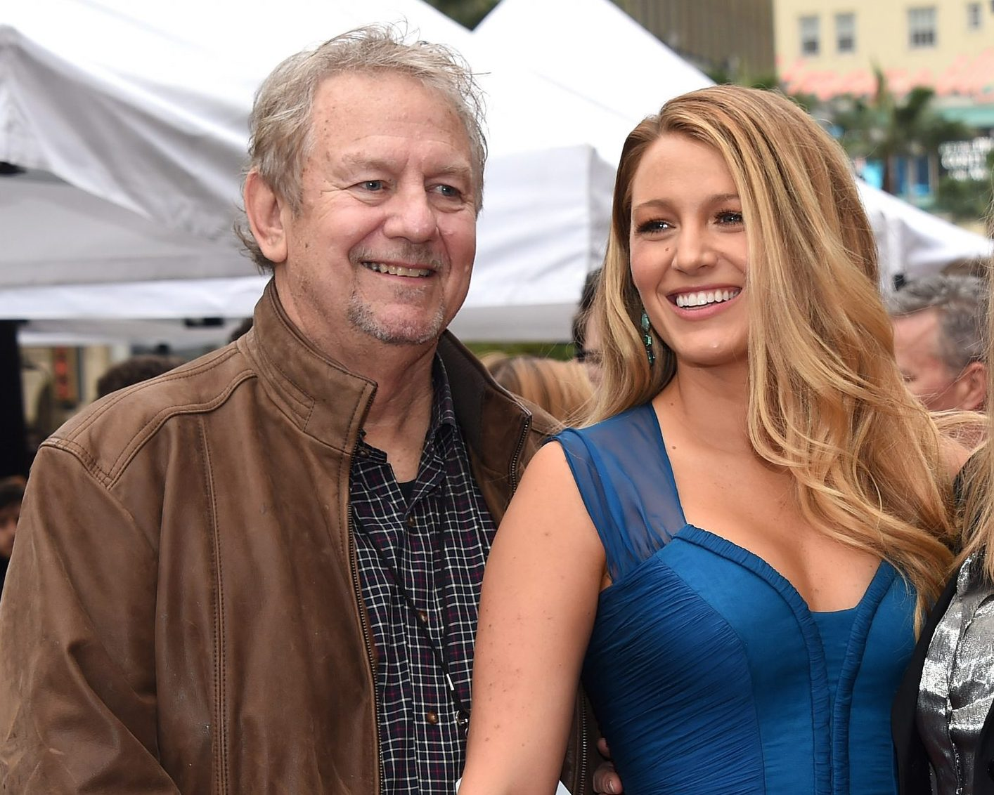 Ernie Lively and Blake Lively at a red carpet event. They are holding hands and both smiling.