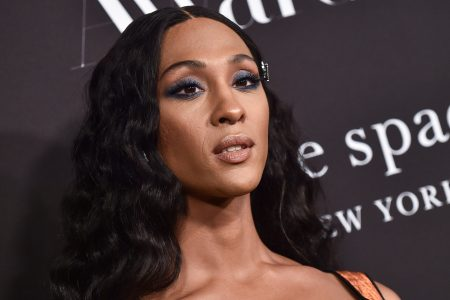 Mj Rodriguez at a red carpet event. She has long black hair and brown skin.