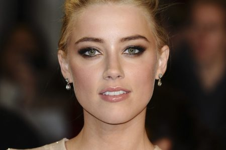 Amber Heard on the red carpet, posing for a photo.