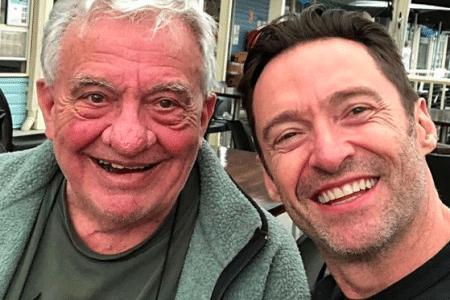 Christopher Jackman and Hugh Jackman smile for a selfie.