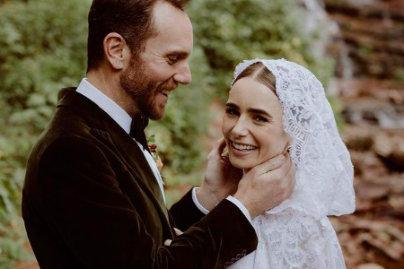 Lily Collins and Charlie McDowell smiling on their wedding day.