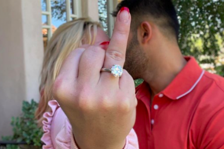 Britney Spears and Sam Asghari engaged! In the photo Britney sticks up her ring finger at the camera while kissing Sam in the background.