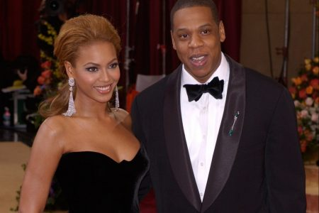 Beyonce and Jay Z smile at a red carpet event.
